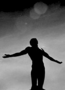 silhouette-man-arms-outstretched-humility-surrender